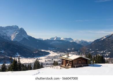 Alpine hut with mount Zugspitze and Garmisch-Partenkirchen, Bavaria, Germany