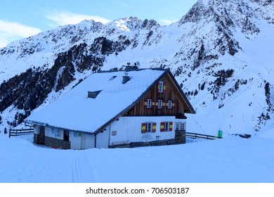 Alpine hut Potsdamer Hutte and mountain panorama with snow in winter in Stubai Alps, Austria