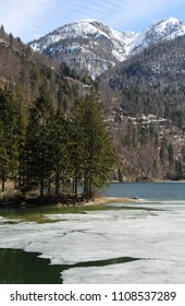 alpine lake called Lago del Predil in Italy near Tarvisio Town and mountains in winter