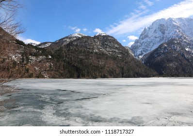 alpine lake called Lago del Predil in Italy near Tarvisio City and mountains in winter