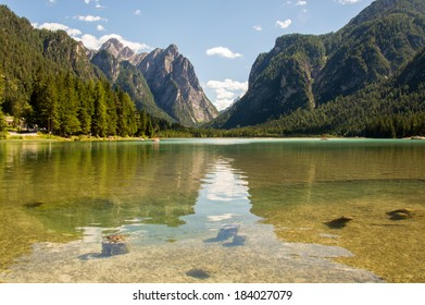 Alpine lake coming from the valley, Lago di Landro, Italy