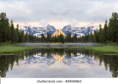 Alpine lake in Dolomites and Sorapis mountain group with reflection in water, Lago di Antorno