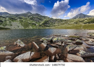Alpine lake and granite rocks in the mountains in summer