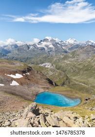 Alpine lake in the Italian Alps. Lake Vago, Livigno. Valtellina