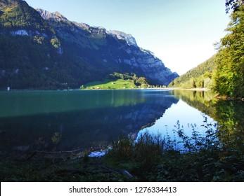 Alpine lake Klontalersee in mountain range Glarus Alps - Canton of Glarus, Switzerland