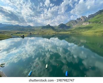 The alpine lake Melchsee or Melch Lake in the Uri Alps mountain massif, Kerns - Canton of Obwalden, Switzerland (Kanton Obwald, Schweiz)