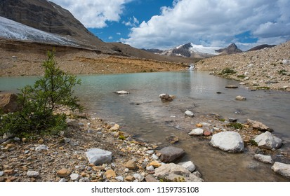 Alpine lake and melting glacier in Canadian Rockies