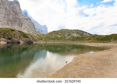 Alpine lake on italian Alps, dolomite, trekking