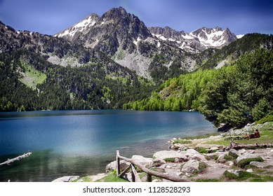 Alpine lake of San Mauricio surrounded by high mountains in the Pyrenees.