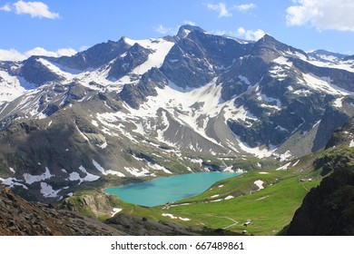 an alpine lake surrounded by mountains