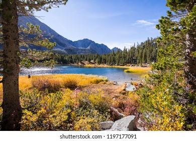 Alpine lake surrounded by the rocky ridges of the Eastern Sierra mountains; Heart Lake, Little Lakes Valley trail, John Muir wilderness, California