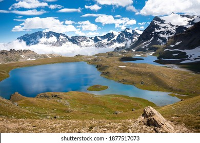 Alpine lakes, fields, and mountains at Lake Rosset in the Gran Paradiso National Park