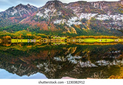 Alpine landscape in autumn at Wolfgangsee lake, Sankt Gilgen, Austria. Picturesque view of Alpine lake and mountains with forests reflected in the water