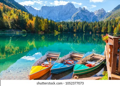 Alpine landscape and colorful boats near Slovenian-Italy border, Lake Fusine,Italy
