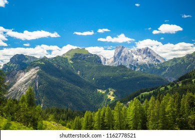 Alpine landscape in the Dolomites, Italy. Trekking on Monte Civetta overlooking the Marmolada Massif.