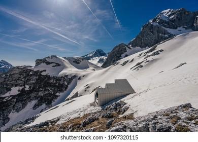 An alpine landscape of Kamnik-Savinja Alps around Skuta mountain. Free public bivouac under the mountain of Skuta in the Alps, Slovenia.