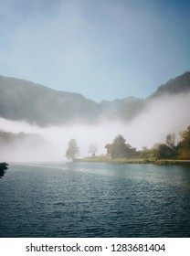 Alpine landscape with lake Königssee in fog beautiful sunny morning, Bavaria, Germany
