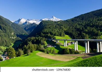Alpine landscape with motorway pass between Austria and Italy
