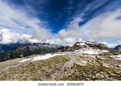 Alpine landscape with rocks, sky and clouds