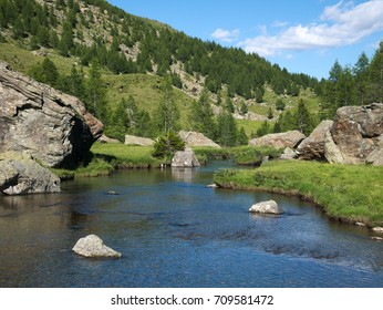Alpine landscape with small river flowing in Valmalenco, northern Italy
