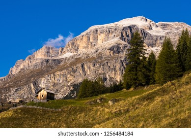 Alpine meadows with mountain hut in the autumnal Dolomites, Alps, Italy
