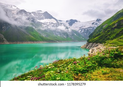 Alpine mountain lake at cloudy day.