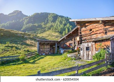 Alpine mountain landscape with pastures and wooden mountain hut in the alps