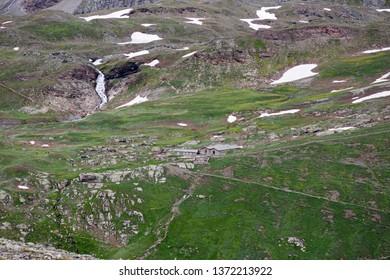 Alpine mountain pasture at Col del Nivolet, in Valle d'Aosta