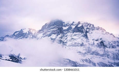 alpine mountain scenery with dramatic sky and clouds