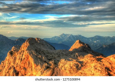 Alpine mountains rising to the sky - Shutterstock ID 1275100894
