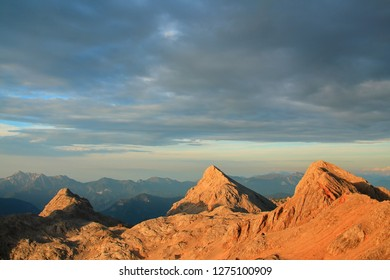 Alpine mountains rising to the sky - Shutterstock ID 1275100909