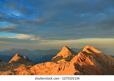 Alpine mountains rising to the sky - Shutterstock ID 1275101134