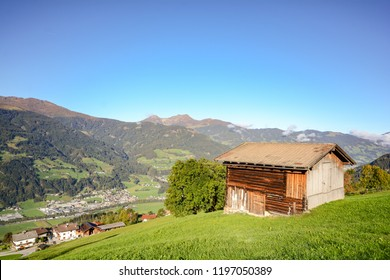 Alpine pasture hike to an old wooden barn with mountain meadow in the austrian alps, Zillertal Austria