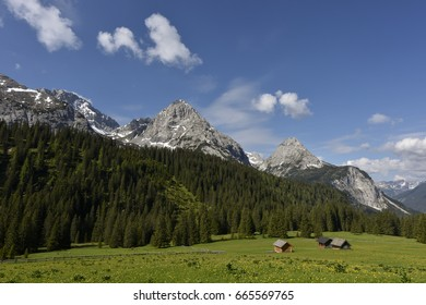 """Alpine pasture with huts in front of the """"Mieminger Kette"""" mountain rang on the path from Ehrwald village  to Coburger Hut, Tyrol, Austria, Europe"""
