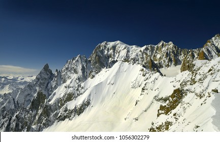 Alpine peaks of the Aiguille Noire de Peutery and Mont Blanc on the border of Italy and France