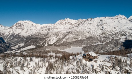 Alpine refuge covered with snow. Winter landscape in Valtellina