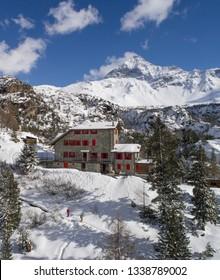 Alpine refuge in the Italian Alps. Winter season and tourism in Valtellina