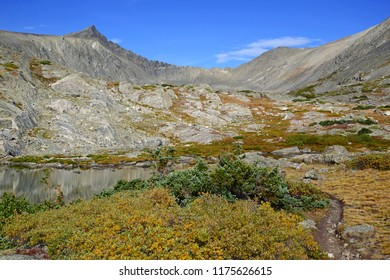 Alpine scene while hiking and climbing in the Rocky Mountains with autumn foliage