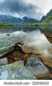 Alpine scenery in the Alps, with storm clouds and glacier lake