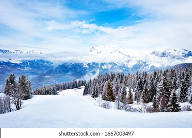 Alpine ski slope and mountain range peaks of Mont-Blanc, Chamonix region, Auvergne-Rhone-Alpes in south-eastern France
