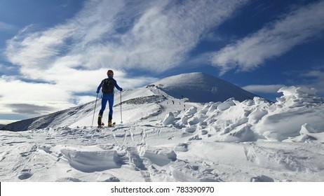 Alpine ski in the snowy mountains