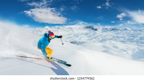 Alpine skier skiing downhill, panoramic format. Winter sports and leasure activities