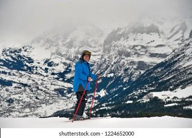 Alpine skier in Swiss Alps. Grindelwald ski resort.