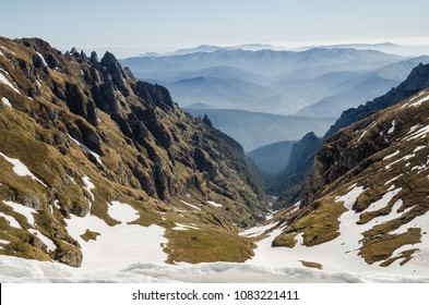 Alpine winter scenery with snow-capped Bucegi Mountains