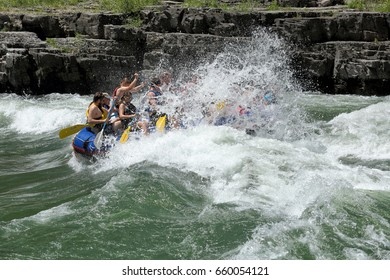 Alpine, Wyoming, USA June 26, 2016 A family rides a rubber raft on the white water rapids of the snake river in western Wyoming.