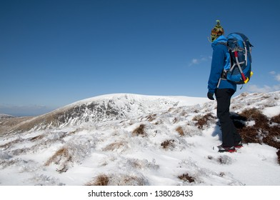 An alpinist in Wicklow mountains in Ireland, Winter climbing