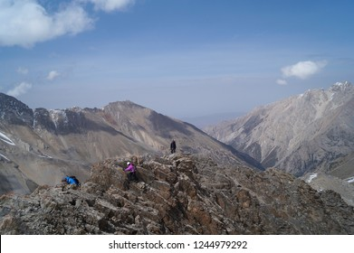 Alpinists climb the ridge of the mountain. Dugoba gorge. Kyrgyzstan.