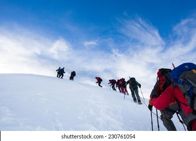 Alpinists climbing Mont Blanc in Alps