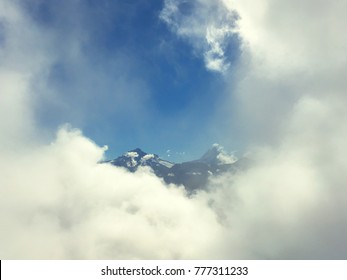 Alps coming up through the clouds