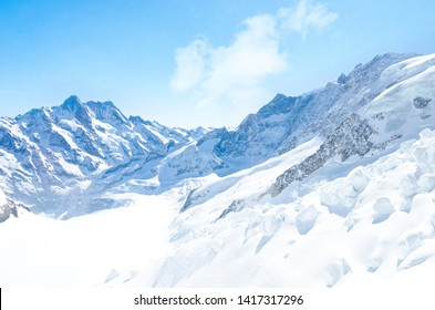 Alps Eiger and Jungfrau dramatic snowy mountain peaks panorama Switzerland.